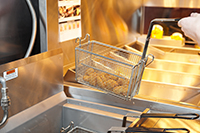 grease fryer in restaurant kitchen